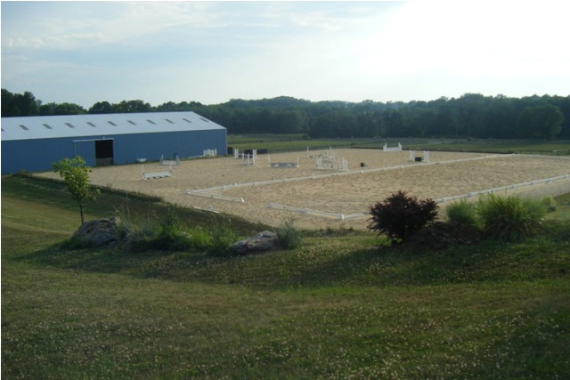 Full size dressage arena and jump course